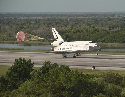 Space shuttle Discovery lands at Kennedy  Space Center in  Florida.