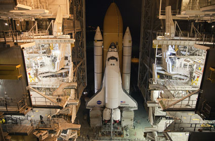 Space shuttle Discovery moves inside the Vehicle Assembly Building.