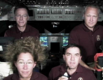 The members of the STS-135 crew answer questions from the media Wednesday. In the back row are Commander Chris Ferguson (left) and Pilot Doug Hurley. In the front are Mission Specialists Sandy Magnus (left) and Rex Walheim. Photo credit: NASA TV