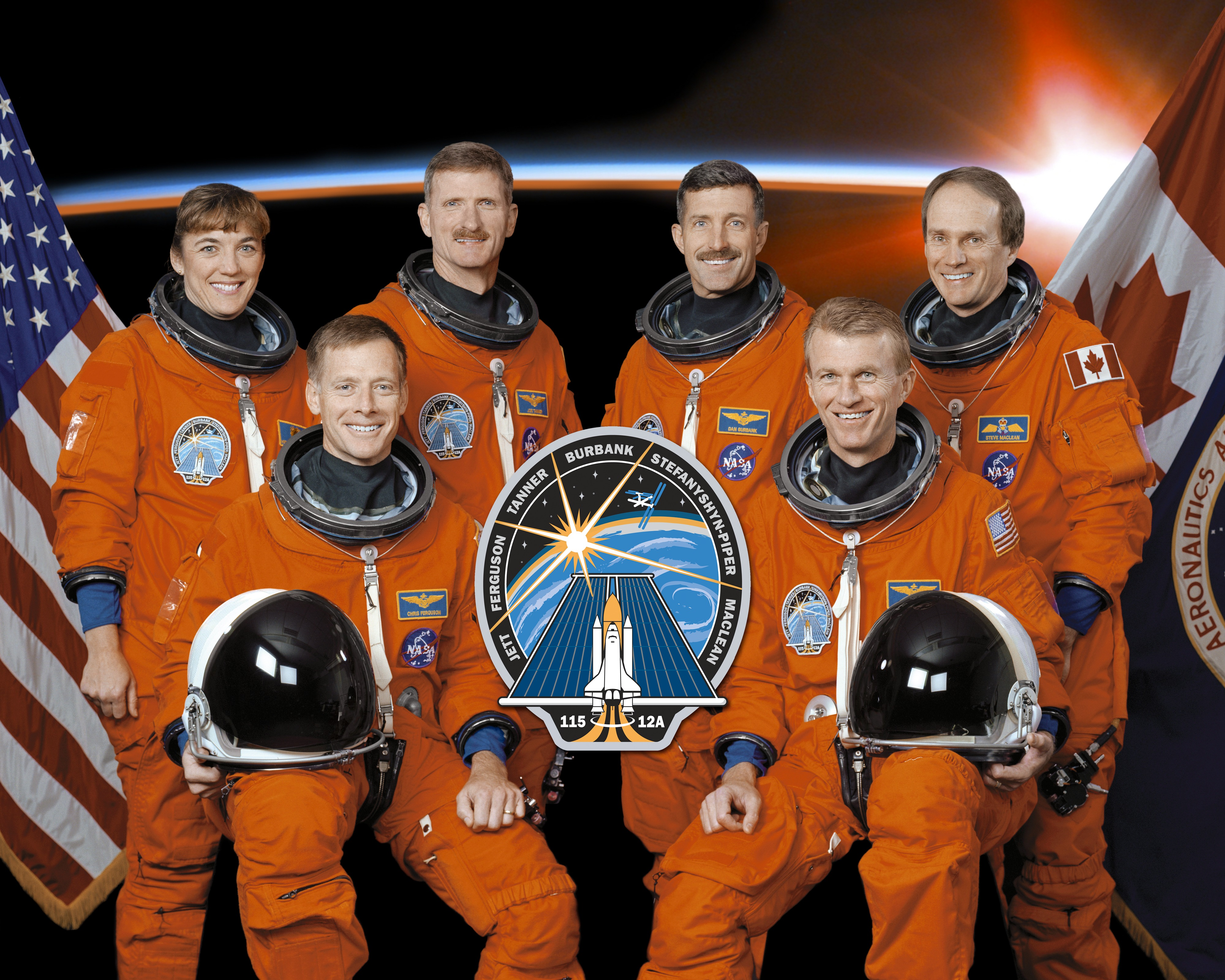 Image above: STS115-S-002 (November 8, 2002) -- These six astronauts take a  break from training to pose for the STS-115 crew portrait.