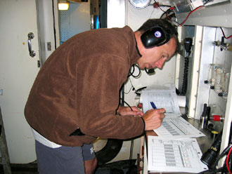 Drew Feustel with logbook
