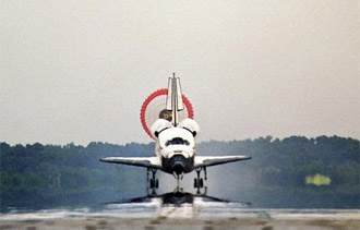 The orbiter Discovery touches down at Kennedy Space Center at the conclusion of STS-121