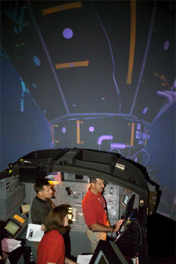 JSC2005-E-17977 -- STS-115 trains in a vehicle simulator