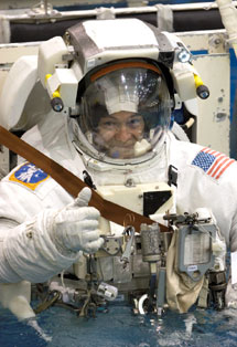 JSC2006-E-08947 : Michael E. Lopez-Alegria gives thumbs-up signal