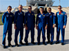 The STS-115 crew poses for the media before a press conference on Launch Pad 39B.