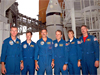 The STS-115 crew poses at Launch Pad 39B.