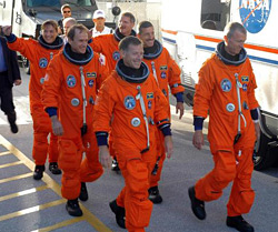 The STS-115 crew departs for Launch Pad 39B.