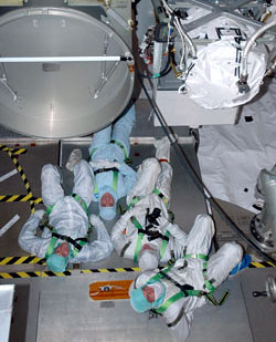 STS-115 crew members lie on their backs to get a look at the truss.