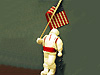 An astronaut figure of clay holding the flag of the United States of America