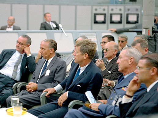 President John F. Kennedy attends a briefing at the Cape Canaveral Missile Test Annex with Vice-President Lyndon Johnson, Secretary of Defense Robert McNamara and other staff.