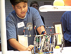 A student prepares a robot for competition