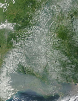 This image of the southern United States from NASA's Moderate Resolution Imaging Spectroradiometer  aboard the Terra satellite shows thick smoke from Canadian forest fires hanging over Louisiana and Texas on July 19, 2004.