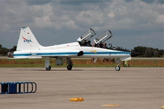 A NASA T-38 jet carrying two STS-115 crew members arrives at Kennedy Space Center