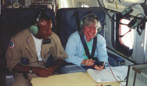 A photo of Ms. Hood (right) preparing to fly on the NASA DC