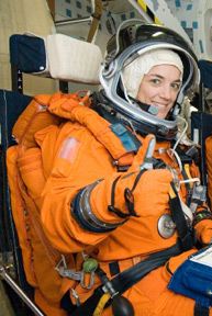 Stefanyshyn-Piper gives a thumbs-up in a shuttle simulator