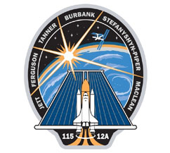 The STS-115 mission patch with crewmembers' names around the border