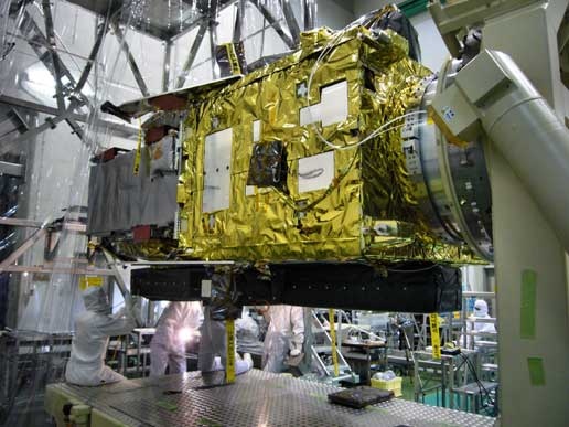 Engineers complete the attachment of the Extreme Ultraviolet Imaging Spectrometer to the Solar-B spacecraft.