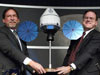 NASA officials pose with a model of Orion