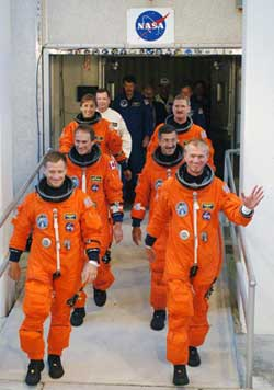 STS-115 crew in orange launch suits.