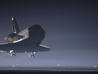 Atlantis touches down at the landing facility.