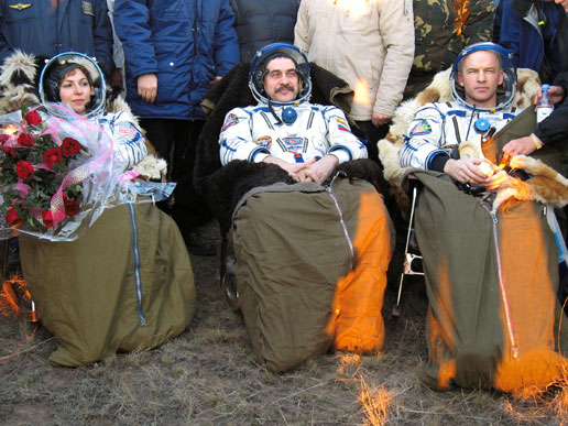 Cosmonaut Pavel V. Vinogradov (center), astronaut Jeffrey N. Williams (right), and spaceflight participant Anousheh Ansari