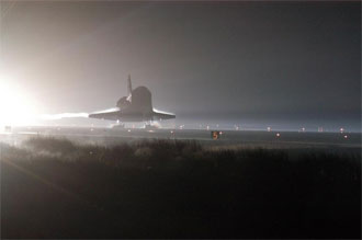 Atlantis touches down at Kennedy Space Center.