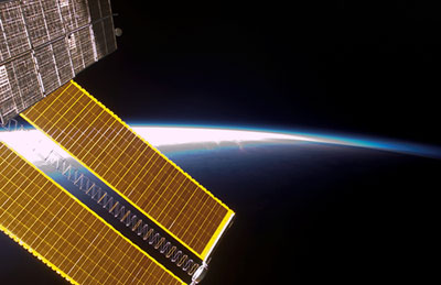 ISS016-E-023499 -- Solar array panels