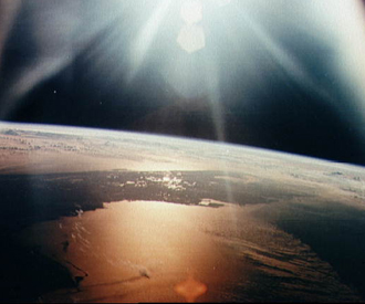 The morning sun reflects on the Gulf of Mexico and the Atlantic Ocean as seen from the Apollo 7 spacecraft during its 134th revolution of the earth.