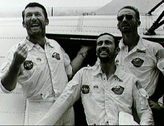 The Apollo 7 crew arrives aboard the U.S.S. Essex, the prime recovery ship for the mission.