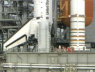 Final Inspection Team works on the mobile launch platform.