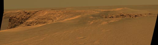 Superimposed artist concept of Opportunity atop the rim of Victoria crater
