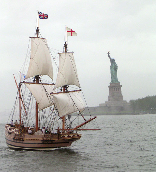 A replica of the 17th century ship Godspeed sails past the Statue of Liberty in New York harbor.
