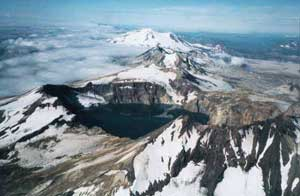 Aerial view along the main volcanic chain from the caldera lake of Mount Katmai, Alaska, across the peaks of Trident Volcano, to snow clad Mount Mageik, a distance of about 12.4 miles.