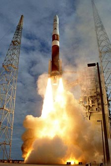 A Delta IV rocket lifts off from the pad.
