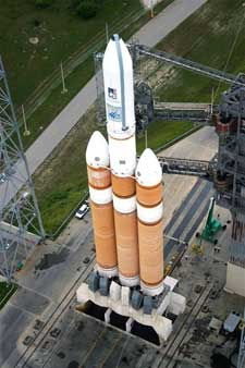 A Delta IV heavy rocket rests on its launch pad.