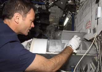 Expedition 14 Commander Michael Lopez-Alegria places a blood sample in the Minus-Eighty Laboratory Freezer for ISS, or MELFI.