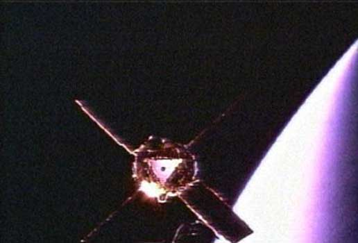 Gravity Probe B spacecraft is shown in orbit around the Earth, as viewed by a camera mounted on the second stage of the Delta II rocket that carried it to space.