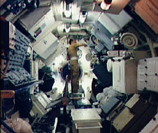 Astronaut Charles Conrad Jr., commander of the first manned Skylab mission, goes through a checklist of experiment activity during Skylab training at JSC. Conrad is standing in the Multiple Docking Adapter (MDA) in the Mission Simulation and Training Facility At JSC.