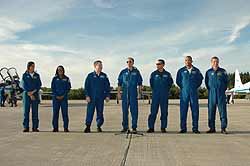 The Discovery crew pose for the media after their arrival to Kennedy.