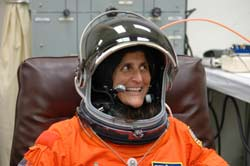 Mission Specialist Sunita Williams dons her launch suit.