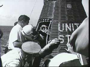 Close up view of Astronaut Walter Schirra being removed from his Sigma 7 capsule.