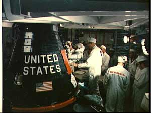 Astronaut Gordon Cooper, Jr. is assisted into his Faith 7 Mercury spacecraft.