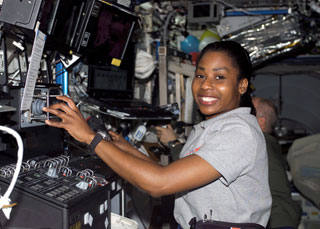 S121-E-07694 : Stephanie Wilson works with robotic controls