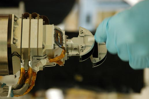 Mars Color Imager, shown with a gloved hand