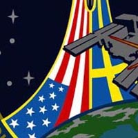 A close-up view of the U.S. and Swedish flags on the STS-116 mission patch