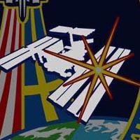 A close-up view of the International Space Station on the STS-116 mission patch
