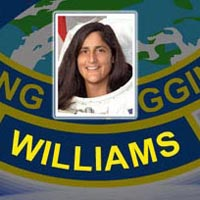 A close-up view of the name Williams on the STS-116 mission patch and a photo of Sunita Williams
