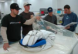 Troy Mann and team wrap a spacewalking suit.
