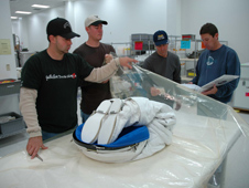 Troy Mann and team wrap a spacesuit.
