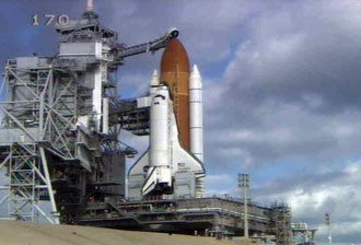 The Space Shuttle Discovery is poised for launch on Pad 39B.